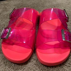 Bright pink plastic slides